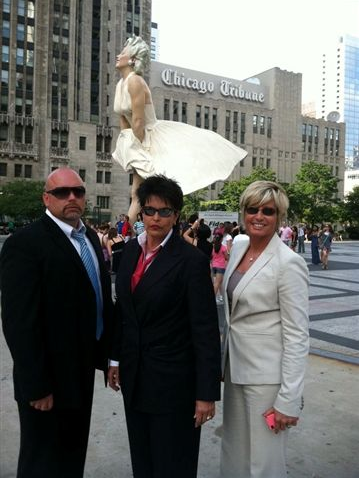 Linda Webb, Fraud Dog, and her team Leigh Mills and Mike Marks in downtown Chicago