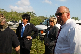 Linda Webb, Fraud Dog with her team on set in the Everglades, Florida