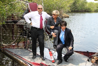 Linda Webb and her fraud fighting team on air boat in the Everglades, Florida